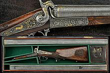 An outstanding original cased double-barrelled center-fire shotgun by B. Pohl