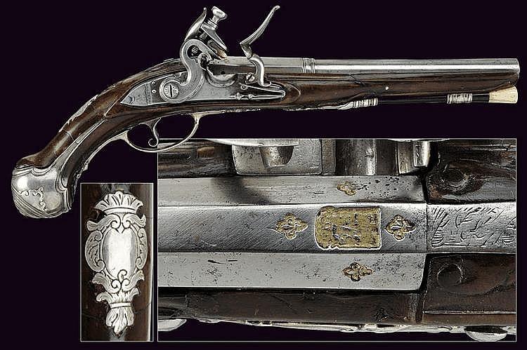 A silver mounted flintlock pistol