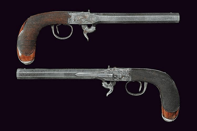 A rare pair of under-hammer percussion travelling pistols