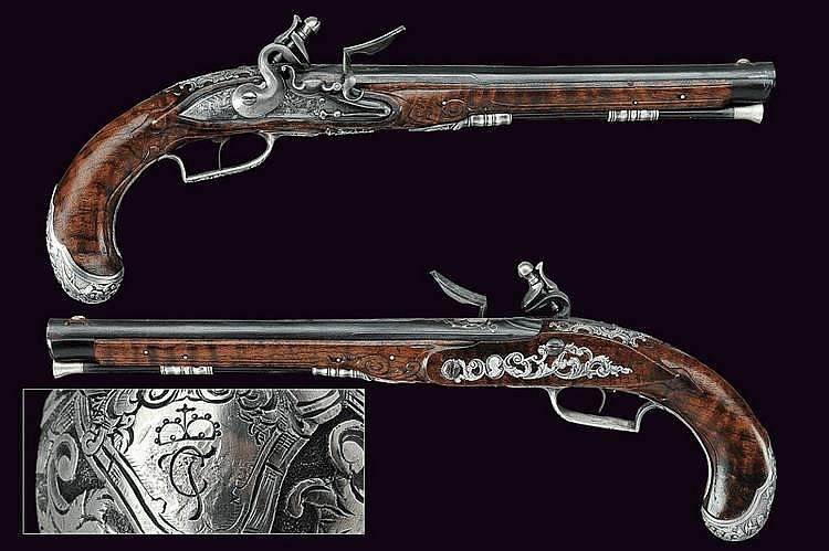 A beautiful pair of flintlock pistols of noble property