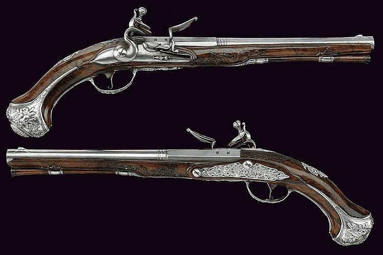 A silver mounted pair of flintlock pistols by Niquet le Jeune
