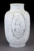 Chinese Qing white porcelain vase in high relief