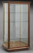 Mahogany curved glass display cabinet