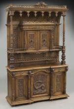 Large Continental carved walnut hunt cabinet,