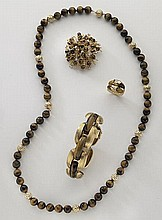 4 Pcs. 18K gold, diamond and tiger's eye jewelry