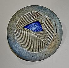 Stoneware Hollow Disc.  Abstract serrated and combed centre with cutout cob