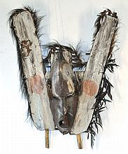 PNG Canoe Prow Shield. Palm spaths & clan mask on