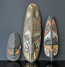 3 Various PNG Masks. 2 hooked beak totemic masks