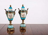 A PAIR OF PAINTED PORCELAIN URNS