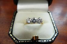 Pre-owned 18ct gold diamond three stone ring