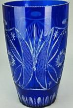 A large antique handcrafted blue cut glass vase