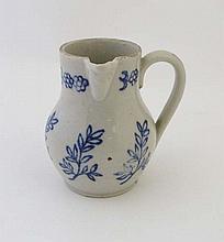 A Continental pottery tin glazed sparrow beak jug