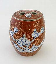 A Chinese barrel shaped tea caddy decorated with