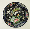 A Chinese enamelled plate with black central body