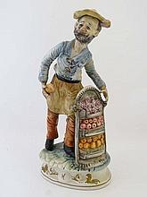 A Capo Di Monte figure of a male fruit seller