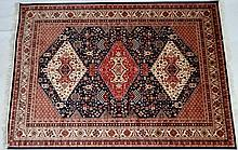 Rug / Carpet :  A Caucasian Carpet with three central diamonds on a blue ground