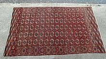 Rug / Carpet : a 1930s Central Asian  / Bokhara  rug with 5 x 14 (70) Field patt