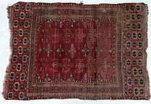 Carpet / rug : an antique Nomadic rug with wine ground , black , orange and salm