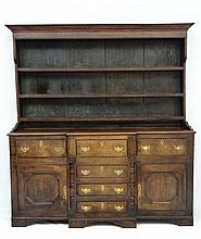 A c.1800 oak break front oak dresser with central drawers flanked by a single dr