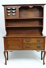 Arts and Crafts : A late 19thC oak narrow dresser with embossed handles to 2 dra