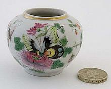 A miniature Chinese famille rose pot, decorated in polychrome with images of but