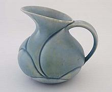 An Art Deco Crown Devon '' London '' jug. Decorated in turquoise with yellow and