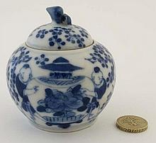 A small Chinese style blue and white lidded pot, decorated with figures and foli