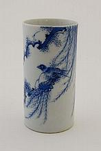 A small Chinese blue and white cylindrical porcelain brush pot , painted with a