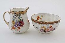 A Royal Doulton porcelain cream jug and sugar bowl having ribbed sides and deco