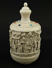 A c.1900 carved ivory large Chinese snuff bottle having carved figures to sides