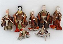 A collection of 7 various Japanese composite dolls tallest 9 3/4