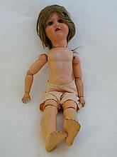 A early / mid 20thC  doll by EVP with blue sleeping plastic eyes, painted featur
