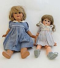 An early 20thC Bisque-head German style doll with blue sleeping glass eyes, pain