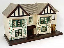 Toy: A Circa 1930's Tri-ang Dolls House with hand painted decoration , front ope
