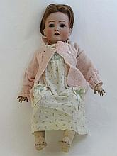 A late 19thC / early 20thC Bisque-head German doll by Simon & Halbig with blue s