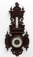 Barometer: a carved wood surround with dolphins aneroid barometer and ename