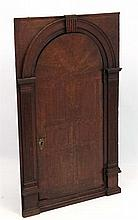 A c.1770 oak corner hanging architectural cupboard with inlaid and banded d