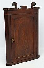 A Regency mahogany hanging corner cupboard 41 1/2'' high