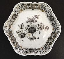 A small Oriental Black and white hexagonal dish decorated to centre with pe
