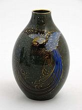 A Royal Doulton '' Titanian '' ovoid vase decorated with a bird of paradise
