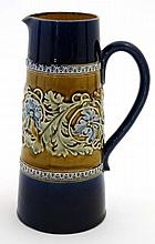 An early 20thC Doulton Lambeth jug, numbered 9511, having floral border on