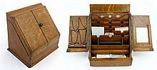 A c.1910 oak stationary cabinet with pen drawer under and calendar having 4