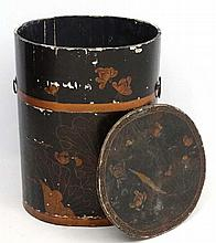 An Oriental lacquered food container with twin carry handles and decorative