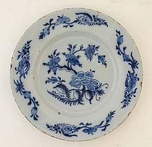 An 18thC Delft plate painted in blue with