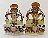 A 19thC pair of Victorian Staffordshire spill