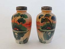 A pair of Japanese silver topped bud vases painted