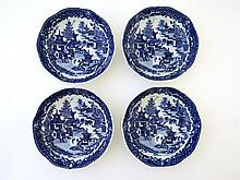 A set of 4 blue and white transfer printed saucer