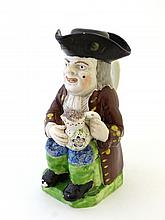 A early 19th Century Staffordshire Toby jug in the