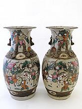 A pair of Japanese vases of Meji period depicting