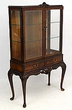 A mid - late 20thC burr walnut Chippendale style d